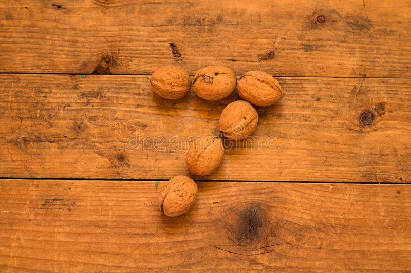Number 7 from walnuts. Top view of english alphabet made from walnuts on a wooden table. Number 7 stock photos