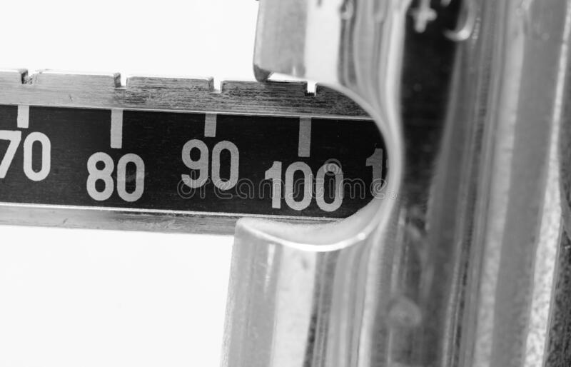 Number 100 in the weight scale. With black and white effect royalty free stock photography