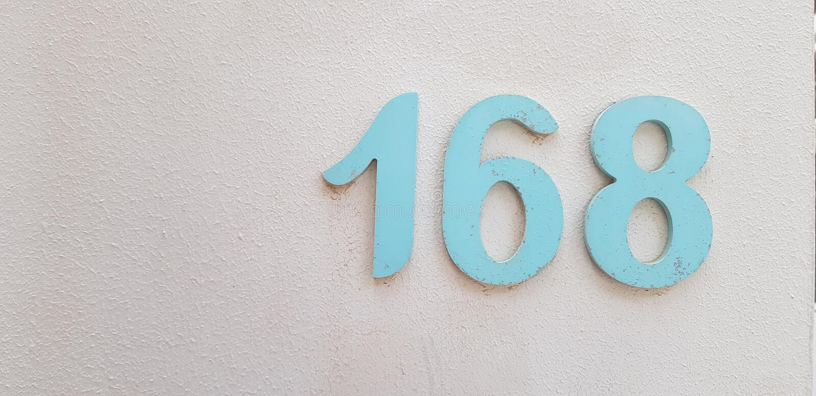 Number 168 on white painted wall royalty free stock images