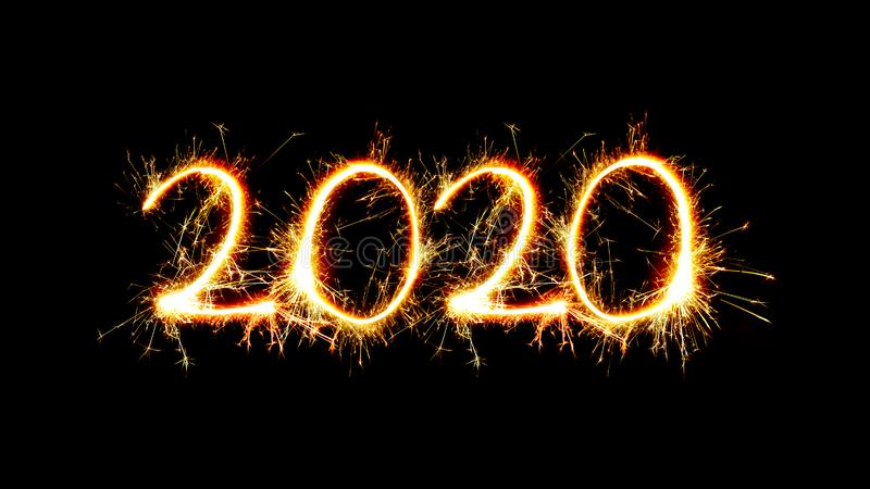 Number 2020 written sparkling sparklers isolated on black background With Copy Space For Text.Happy New Year 2020 royalty free stock images