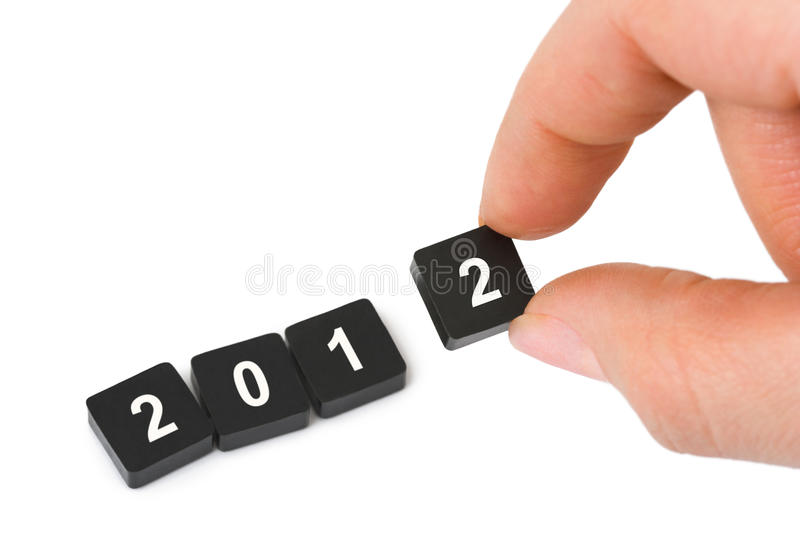Numbers 2012 and hand royalty free stock photo