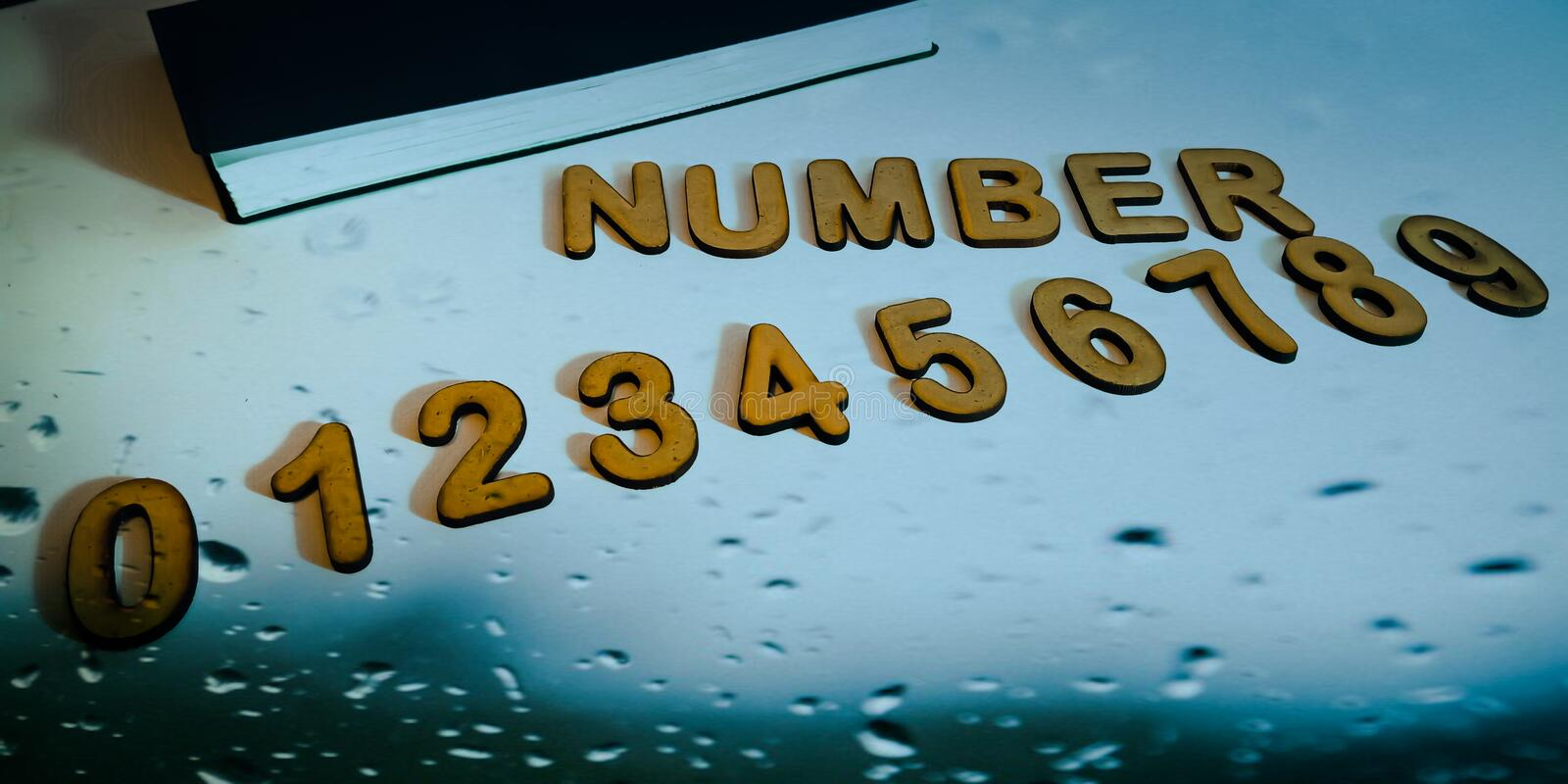 numbers displayed on water drop abstract background with diary royalty free stock photography