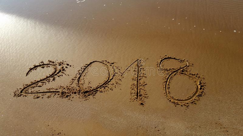 Numbers 2018 drawn in the beach royalty free stock photography