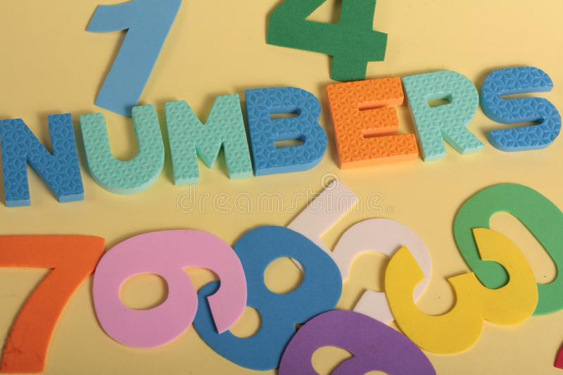 Numbers fun letters. On a yellow background royalty free stock photo