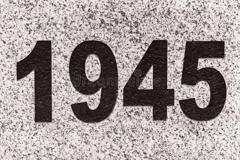 Numbers 1945 on a marble slab. Black numbers figures 1945 on a marble slab. 1945 year the end of the Great Patriotic War stock images