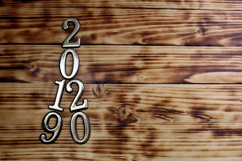 On the wooden surface is the number 2019 passing to 2020 stock photos