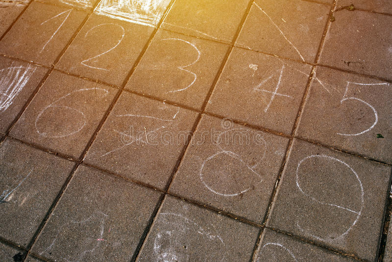 Numbers on the pavement stock photos