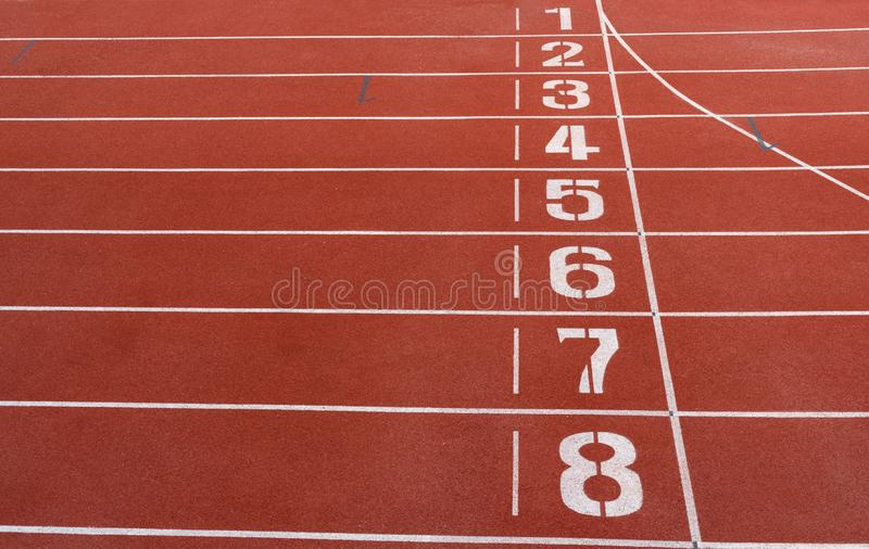 Numbers on red running track.  royalty free stock photos