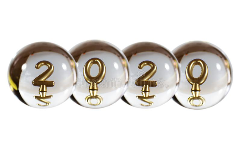 Numbers of 2020 in the reflection of the crystal ball royalty free stock images