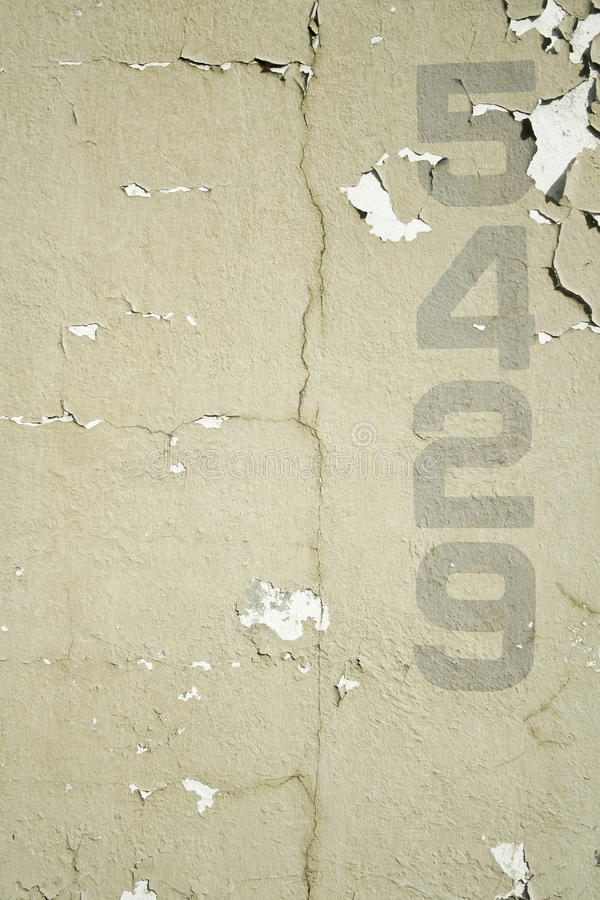 Numbers stencilled on old wall background royalty free stock images
