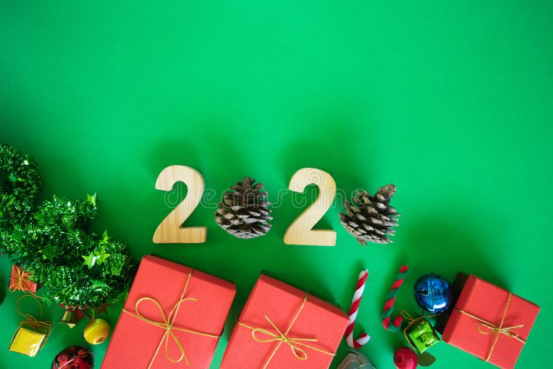 2020 numbers, symbols celebration of  new year and pine cones with colorful red gift boxes, balls Christmas and Happy sign Green royalty free stock image