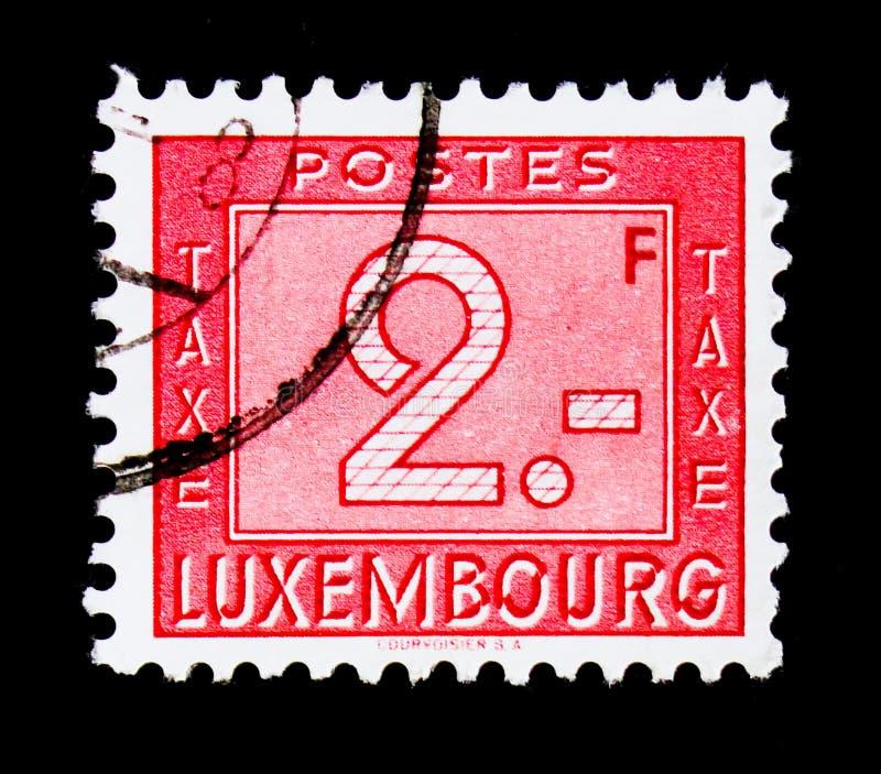 Numerais - porte postal devido, serie, cerca de 1946 fotografia de stock royalty free
