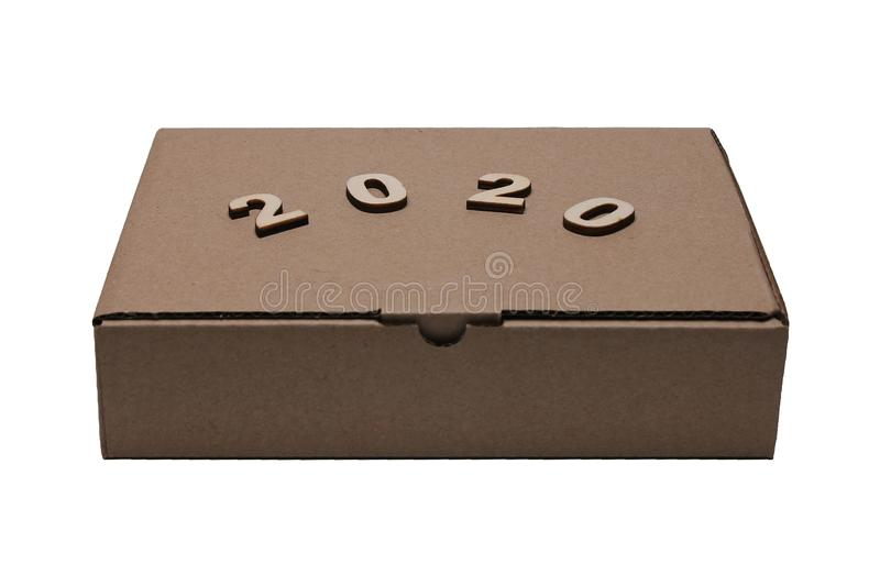 2020 numerals of the new year on the Cardboard brown closed rectangular box stock photos