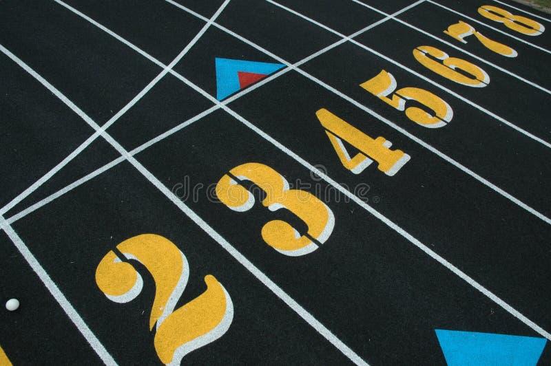 Numeri del vicolo dell'atletica leggera fotografia stock