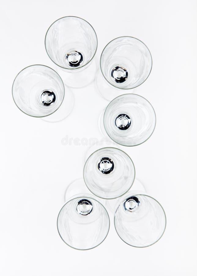 Numeri di vetro del champagne vuoto fotografie stock