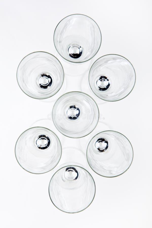 Numeri di vetro del champagne vuoto immagini stock libere da diritti
