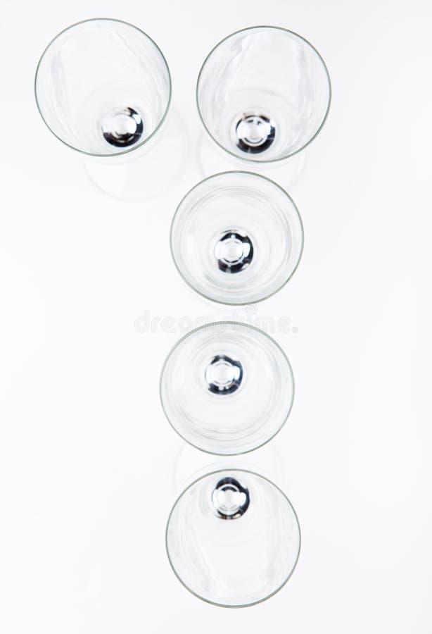 Numeri di vetro del champagne vuoto fotografia stock libera da diritti