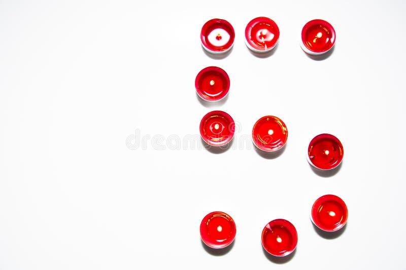 Numeri fatti delle candele colorate fotografia stock