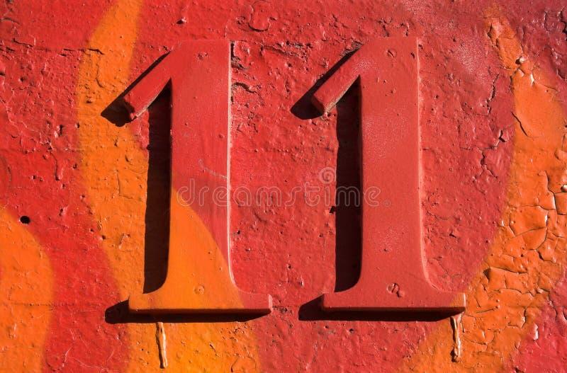 Numero grungy rosso 11 fotografie stock