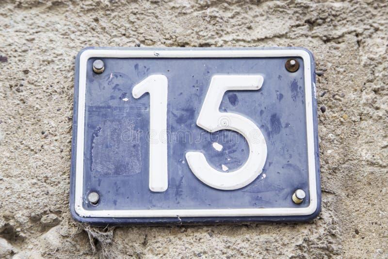 Numero quindici in una parete di una casa fotografia stock libera da diritti