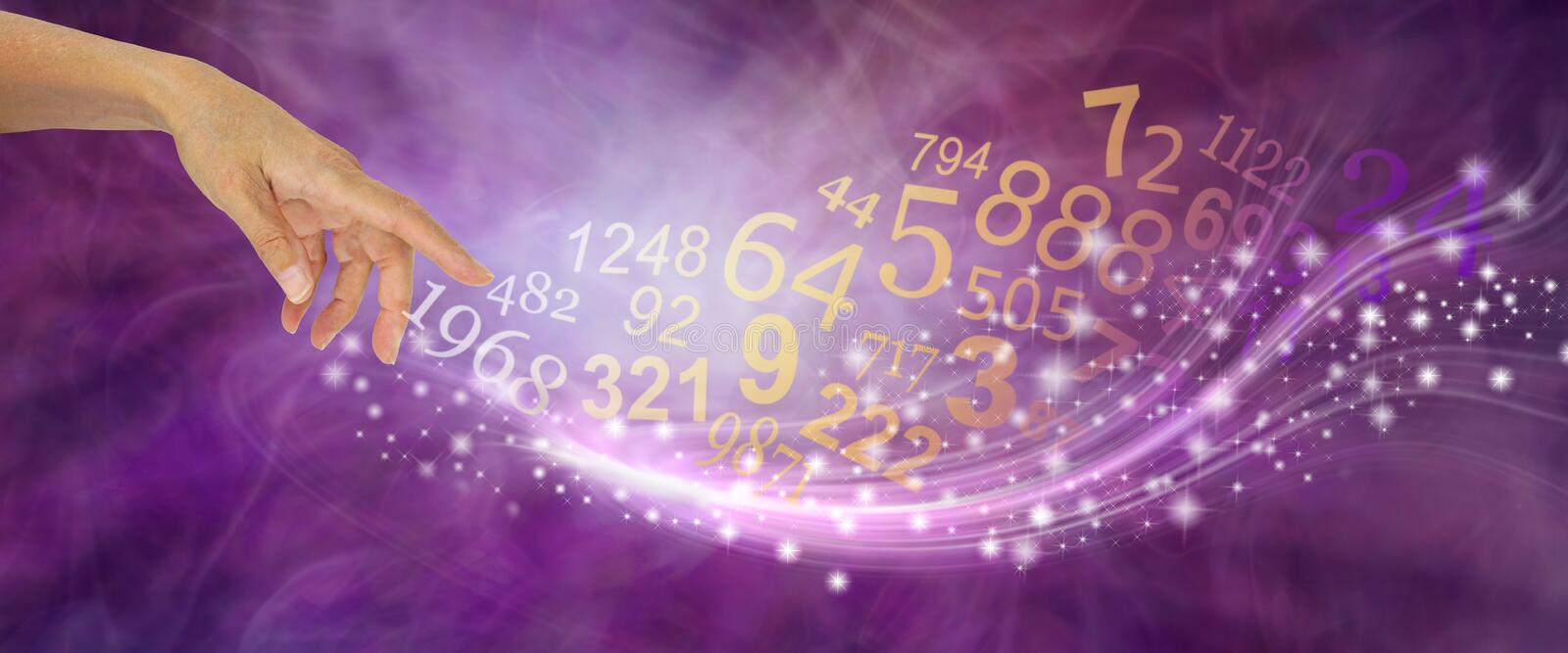 Numerology is far more than just NUMBERS. Female hand appearing to create a swish of sparkles and a flow of random numbers on a pink purple energy formation stock photo