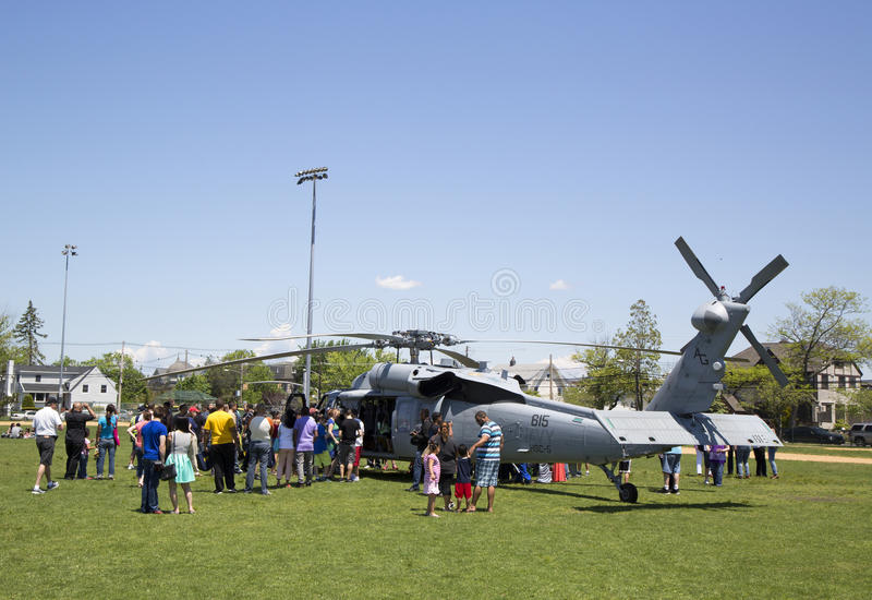 Numerous spectators around MH-60S helicopter from Helicopter Sea Combat Squadron Five during Fleet Week 2014 royalty free stock photography