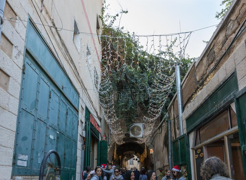 Numerous tourists walk along the streets of Nazareth city decorated for Christmas in Israel stock images