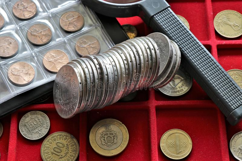 Numismatic job. World coins collection, investment. Accessories are visible in the background stock photo
