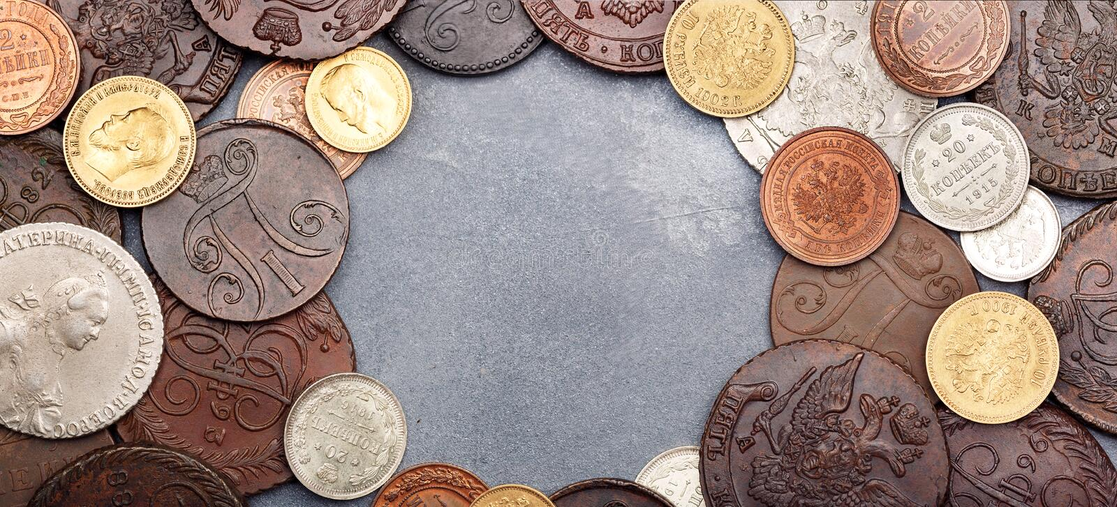Numismatics. Old collectible coins made of silver, gold and copper on a table. Top view stock photo