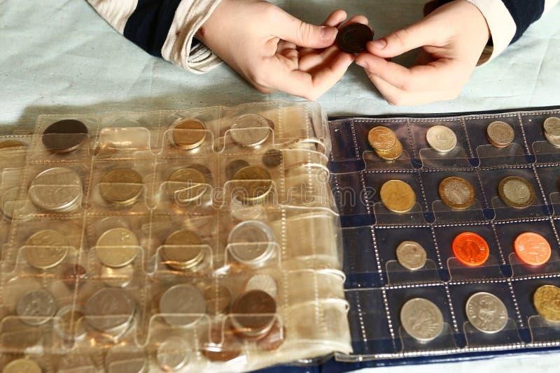 Numismatisk samling för myntalbum royaltyfria foton