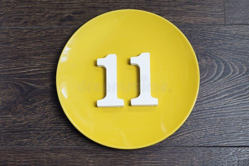 Nummer elva på den gula plattan royaltyfri bild
