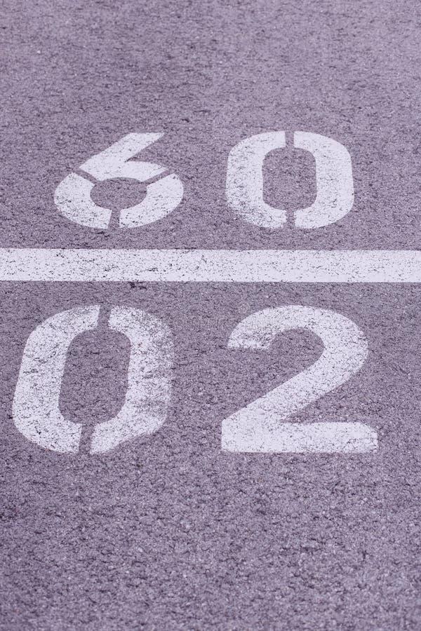Nummer i betong fotografering för bildbyråer