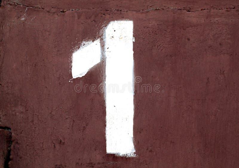 Nummer 1 i stencil på metallväggen fotografering för bildbyråer