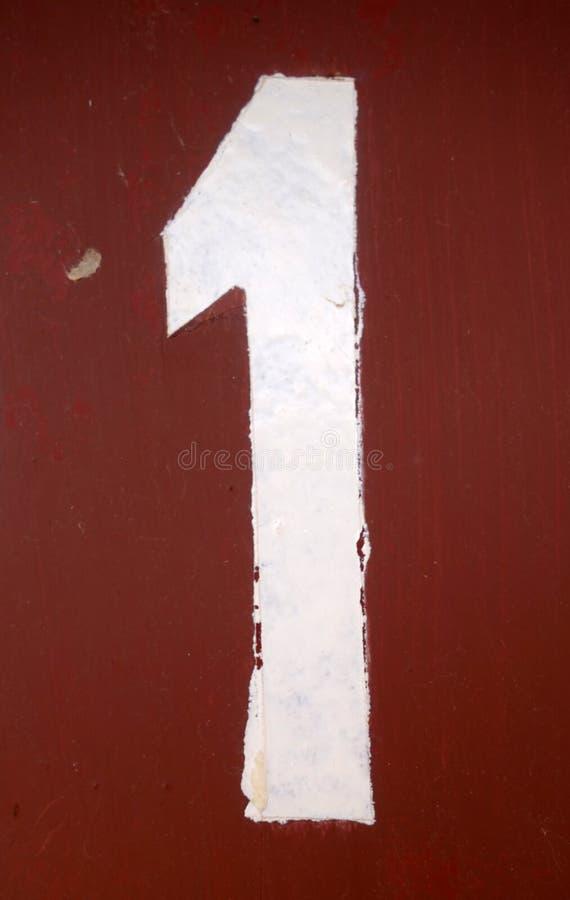 Nummer 1 i stencil p? metallv?ggen fotografering för bildbyråer