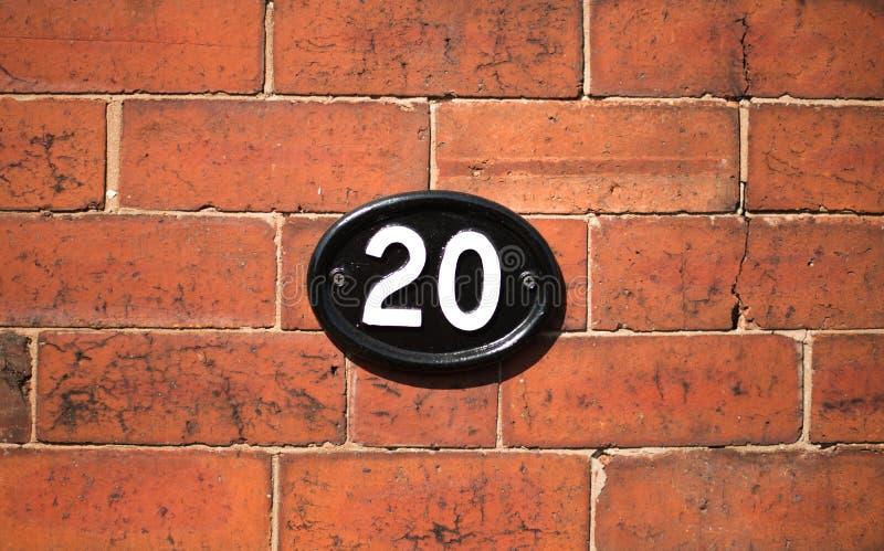 Nummer 20 tjugo på väggen royaltyfria bilder