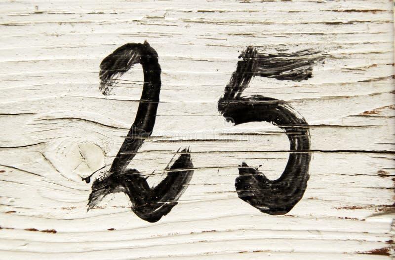 Nummer tjugofem i trä arkivbild