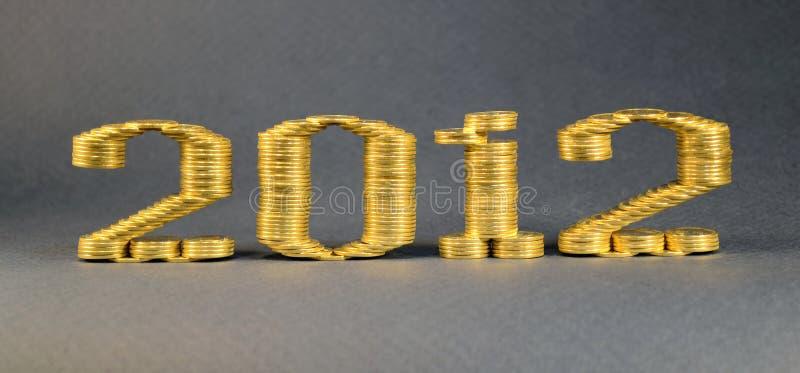 Nummer twee duizend twaalfde gelegde stapels muntstukken royalty-vrije stock foto