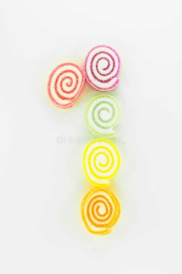 Nummerieren Sie 1 geschrieben mit Scheiben von getrockneten süßen Süßigkeiten stockbilder