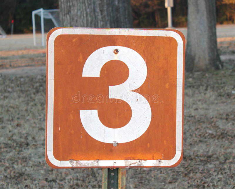 Numrera tre arkivfoton