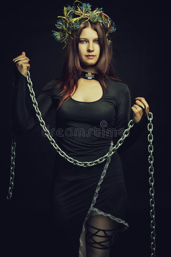 Nun with chains royalty free stock photo