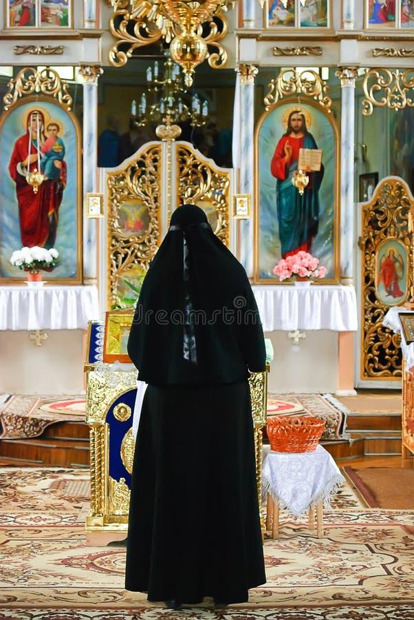 Nun in the church stock photography
