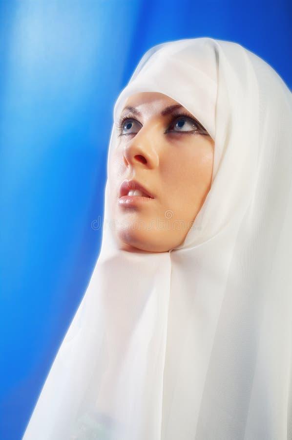 Nun praying stock images