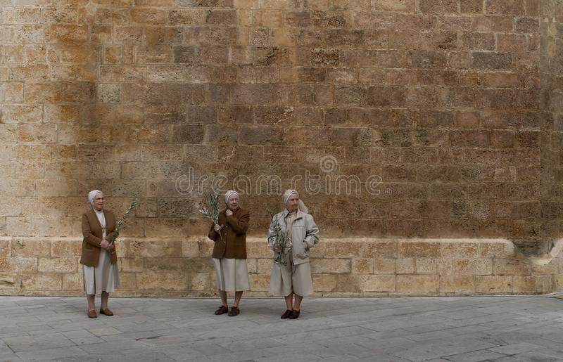 Nuns outside the church before an easter mass in mallorca royalty free stock image