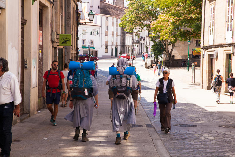 Nuns pilgrimn go to the Santiago cathedral. SANTIAGO, SPAIN - AUGUST, 17: Nuns pilgrimn go to the Santiago cathedral, Way of St. James on August 17, 2016 on royalty free stock images