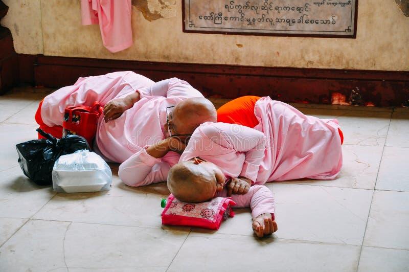 Nuns sleeping near the Shwedagon Pagoda in Yangon. royalty free stock image