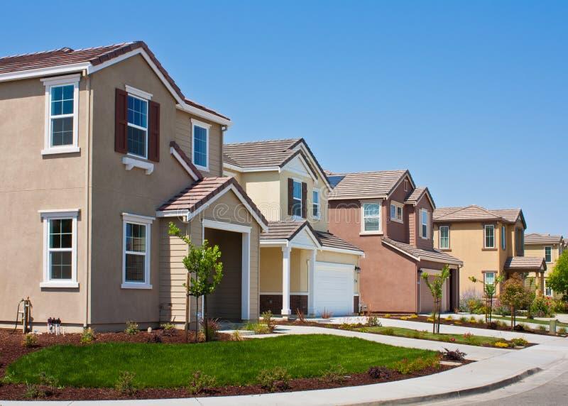 Nuove case del tratto immagine stock