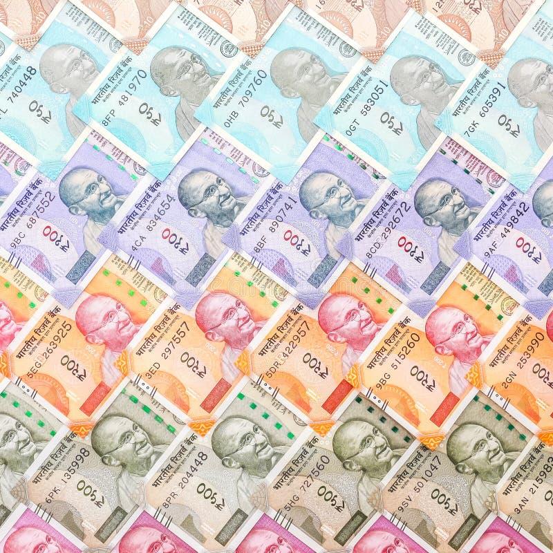 Nuove di banconote degli indiani 10, 50, 100, 200, 500 e 2000 rupie Fondo variopinto del modello del denaro contante immagine stock
