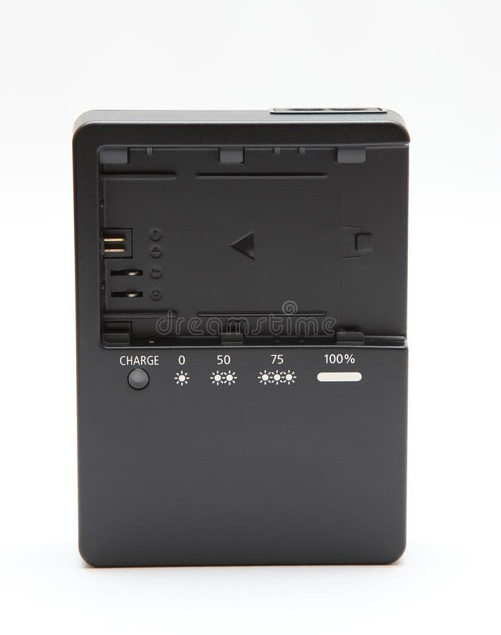 Nuovo caricabatteria della macchina fotografica fotografia stock libera da diritti