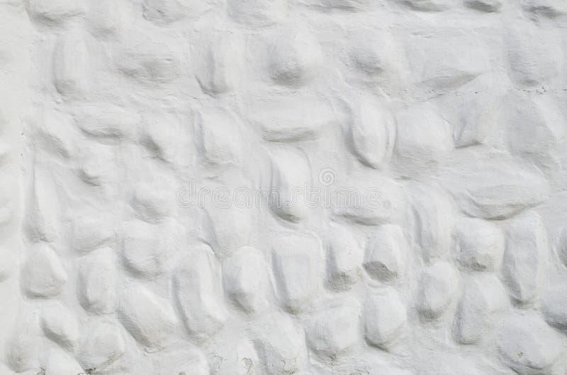 Nuovo gesso bianco decorativo di sollievo con gli elementi convessi arrotondati fotografia stock libera da diritti