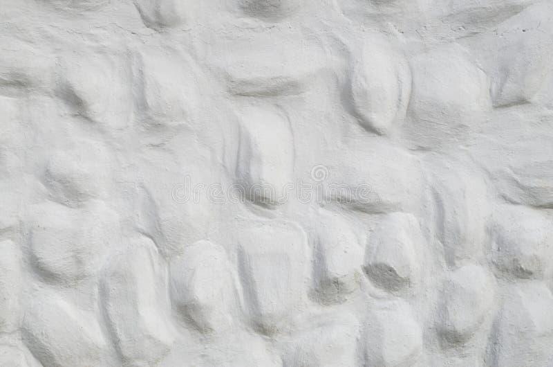 Nuovo gesso bianco decorativo di sollievo con gli elementi convessi arrotondati immagine stock